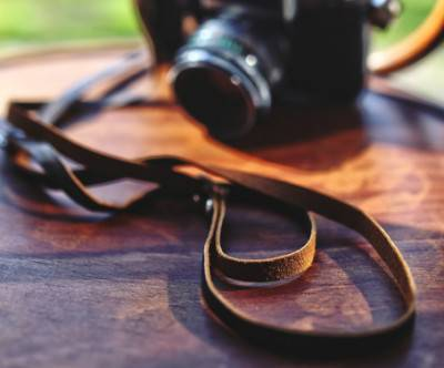 photo-camera-leather-strap-bokeh