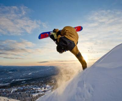 photo-snowboard-trick-sun-landscape