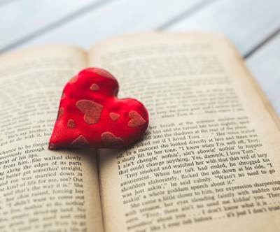 photo-red-heart-old-opened-book]